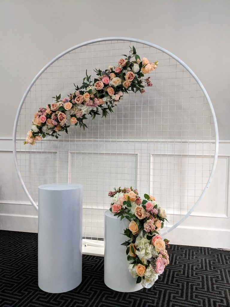 Mesh Backdrop with Custom Florals & Plinths